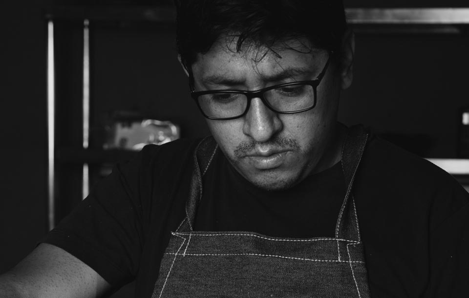 Black and white photo of Cusco's vegetarian chef Fabricio Durand at his kitchen in Green Point Restaurants Cusco.